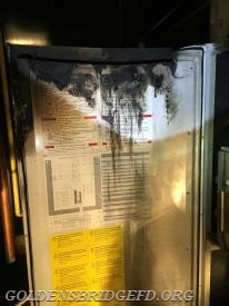 A inside view of the panel door that burned.