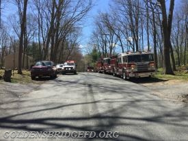 A look down the street showing Mount Kisco Car 2283 & Engine 104, Somers Car 2443 & Engine 183, Westchester EMS 45 Medic and Golden's Bridge Engine 140