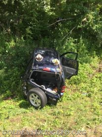 The vehicle involved in the rollover after the victim was removed.