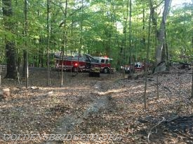 A look from the trail leading into the woods, showing Somers units operating.