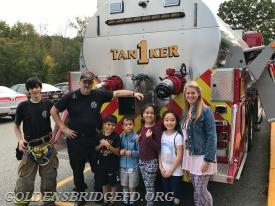 A LESSON IN FIRE SAFETY… Students at Increase Miller Elementary School took a break from reading, writing and arithmetic – and their classrooms became fire trucks when members of the Golden's Bridge Fire Department recently spent an entire day at the school providing interactive demonstrations and presentations as part of National Fire Prevention Week. Second grade students (l.-r.) David Corrales, Chase Carvajal, Rashelle Damian Delacruz and Hannah Jeon, and their teacher Ms. Trisha Patwell (far r.), learned some important lessons in fire safety from Golden's Bridge Fire Department 2nd Assistant Chief Walter Hughes (2nd l.) and Firefighter Doug Orlovitz (far l.). Both products of IMES and the Katonah-Lewisboro school system, Hughes and Orlovitz encouraged students to discuss multiple escape routes and a designated meeting place a safe distance outside their house in the event of a fire.