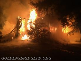 A look at one side of the house involved with heavy fire conditions.