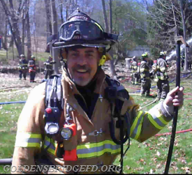 Firefighter King operating a House fire in Katonah this past April. Seen here with that big smile on his face.
