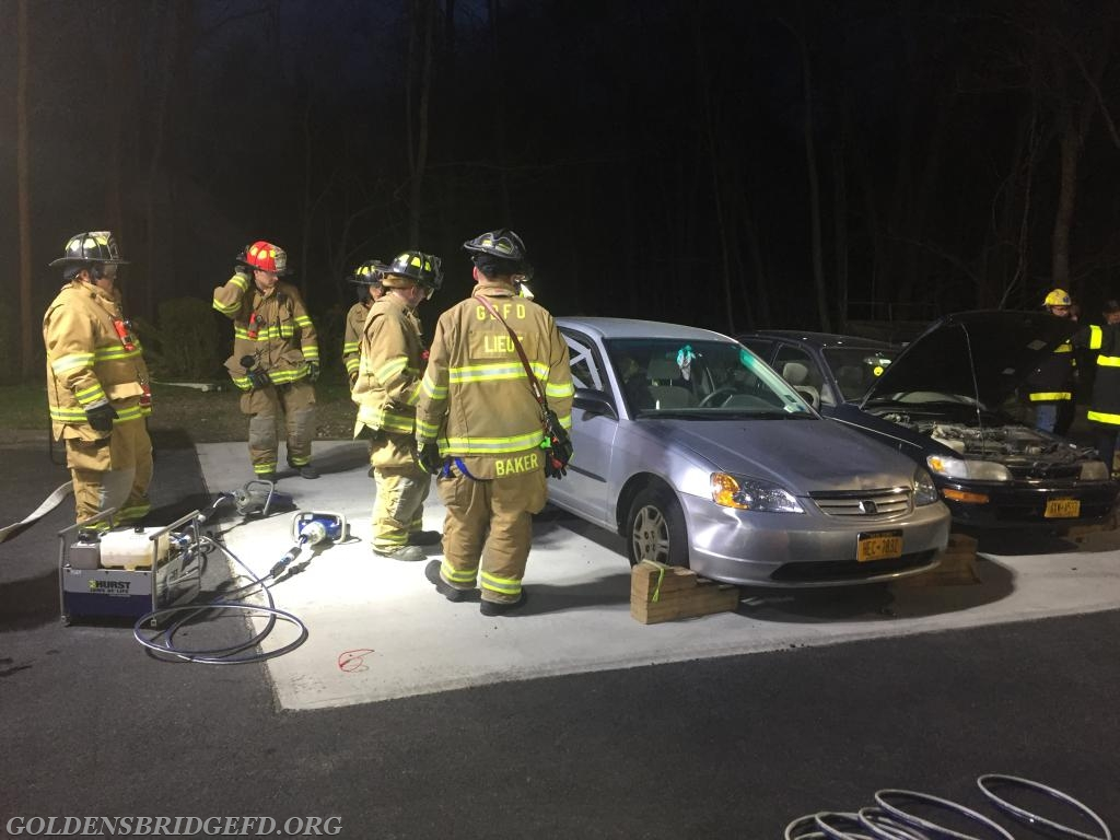 GBFD members planning their best method of removing the door from the car.