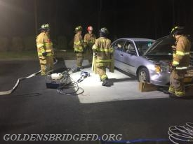 GBFD members stabilizing the car.