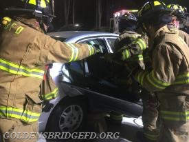 GBFD members removing the rear door of the car.