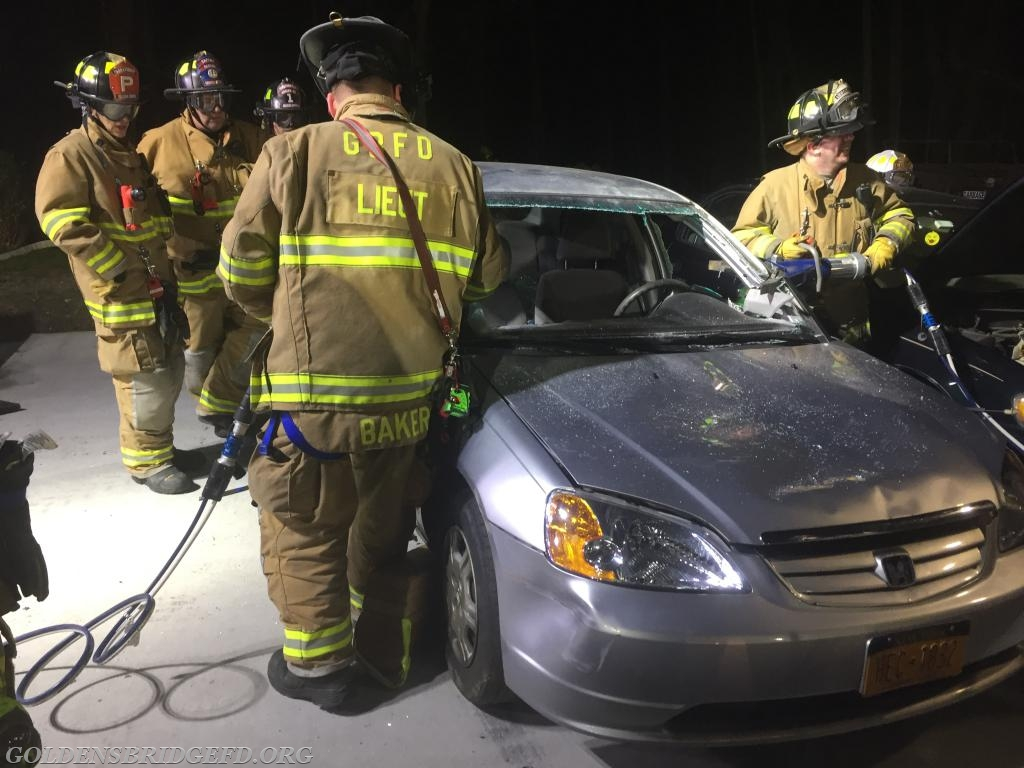 Lieutenants Baker Jr and Dente begin to remove the roof by cutting the posts of the car.