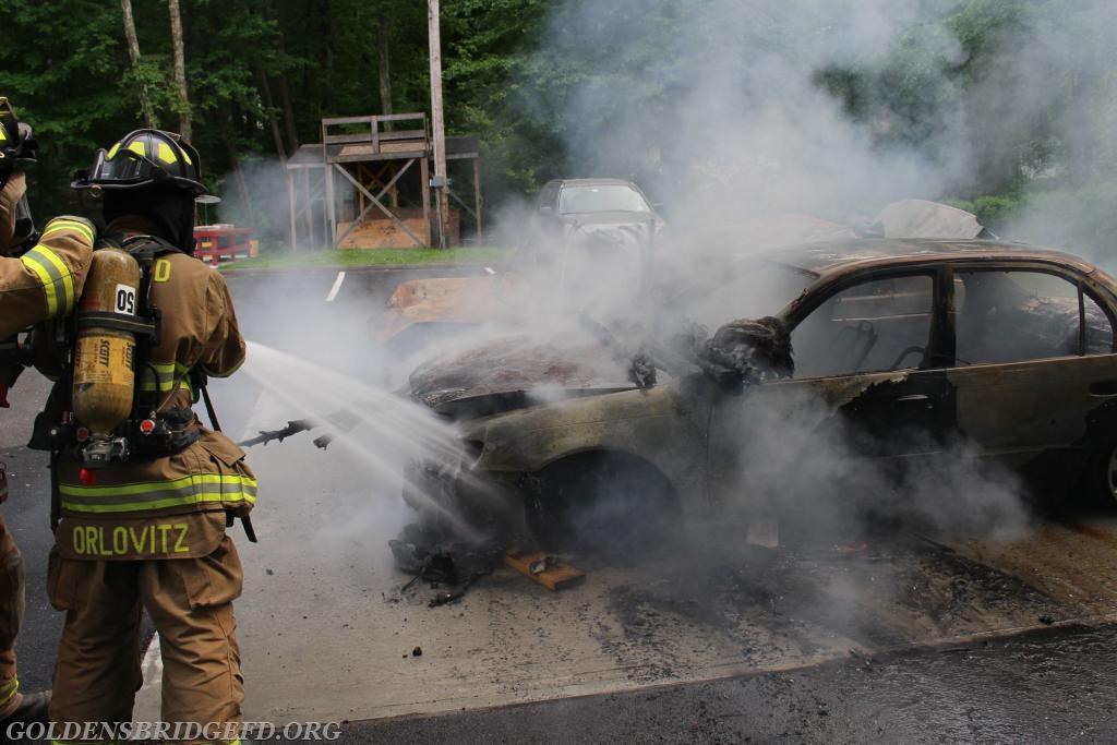 Firefighter/EMT Orlovitz on the nozzle of the hoseline.