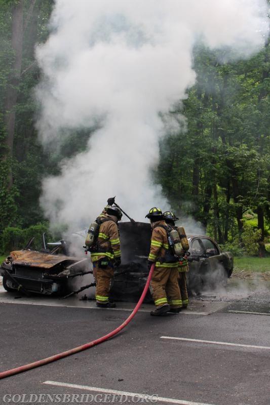 Lieutenant Baker Jr. going over engine fire tactics.