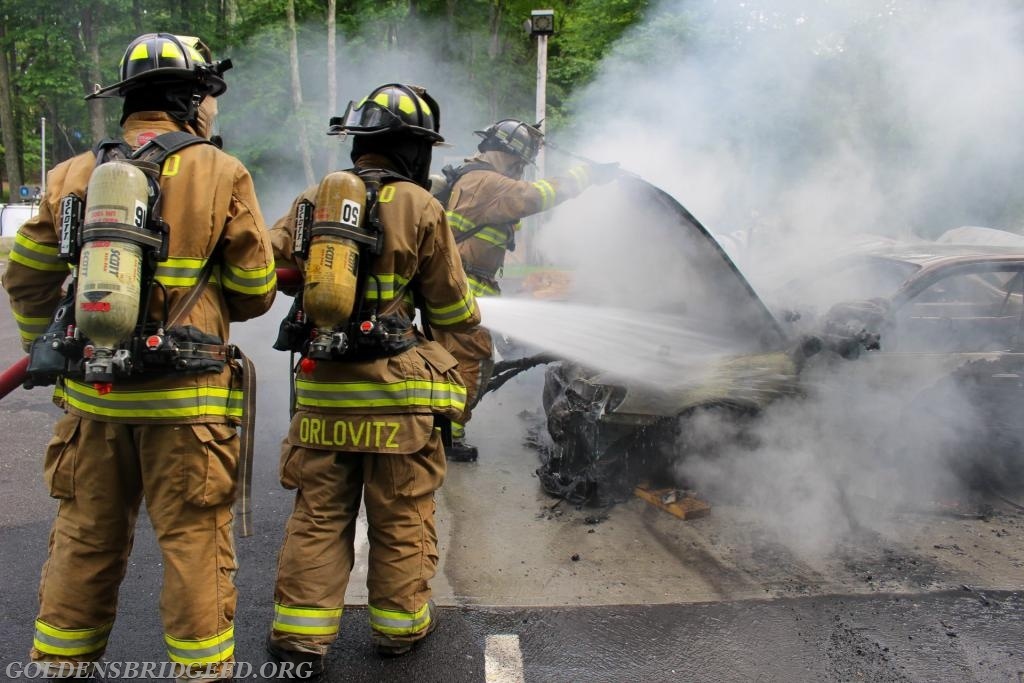 Another shot of the hoseline crew attacking fire after access was made to the engine compartment.