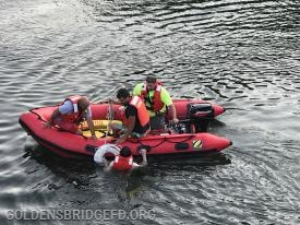 CFFD Marine  crew pulling the victim into the boat.