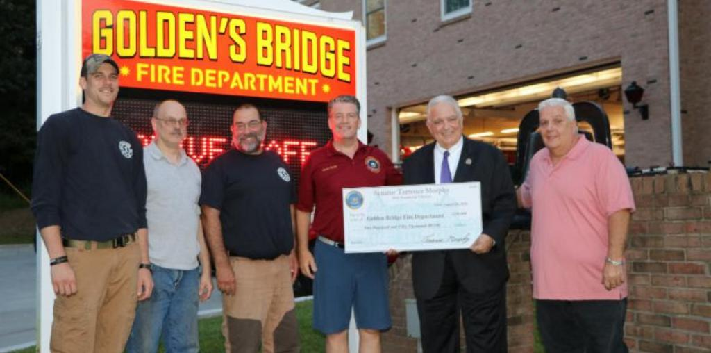 From Left: Chief James McManus, Capt. Ray Baker, Sr,. 1st Asst. Chief Albert Melillo, Senator Murphy, Commissioner Edward Brancati and Commissioner Joseph Simoncini
