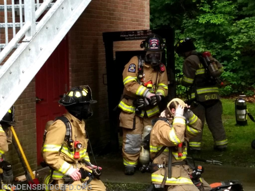 GBFD crew led by Rescue Captain Raymond Baker Jr. prepare to enter for a fire attack.