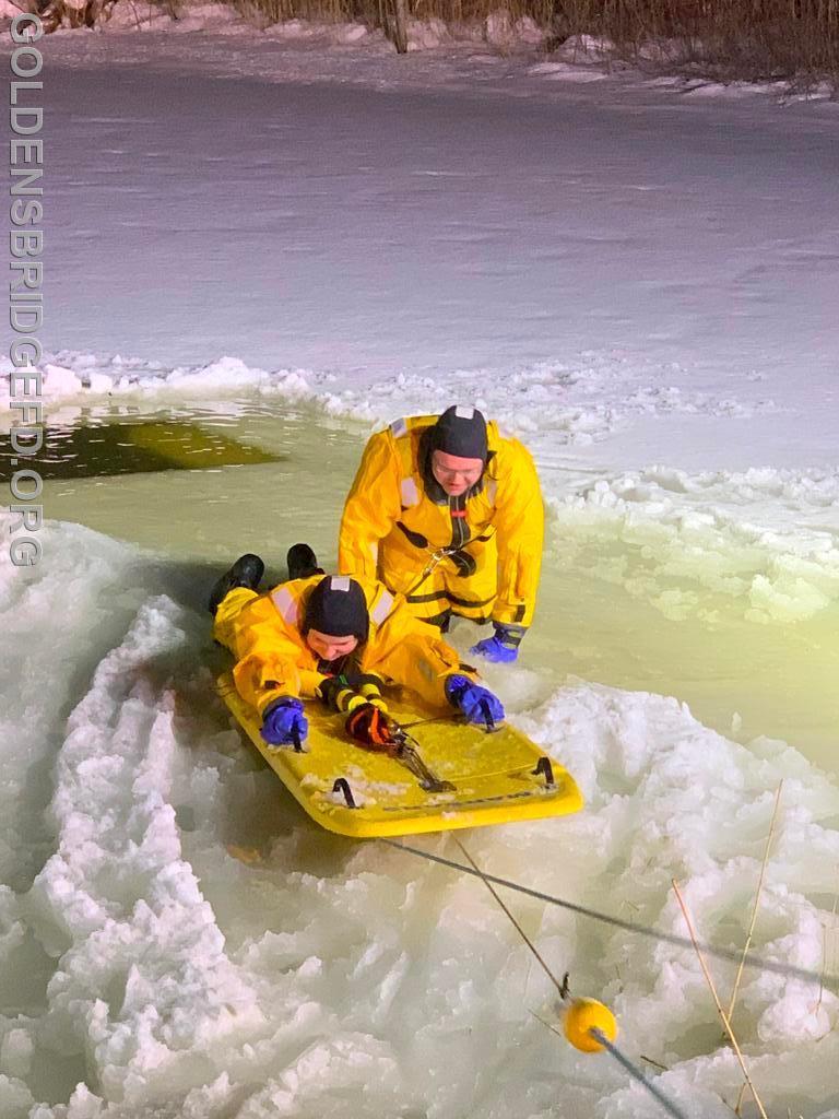 Lieutenant/EMT Raymond Baker Jr. rescuing Firefighter/EMT Nicole Warshaw