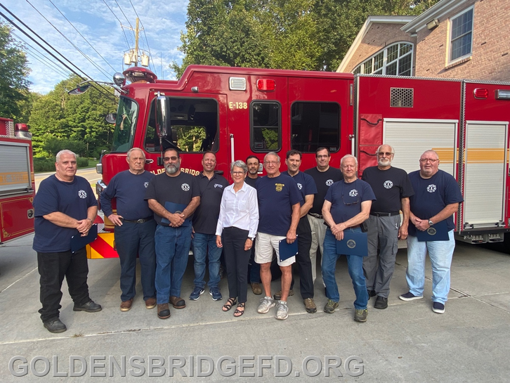 In a ceremony this week at the Golden's Bridge Firehouse, Westchester County Legislator Kitley Covill honored a group of firefighters of the Golden's Bridge Fire Department with 25 or more years of service as volunteer emergency first responders. (Stephen Mangione)