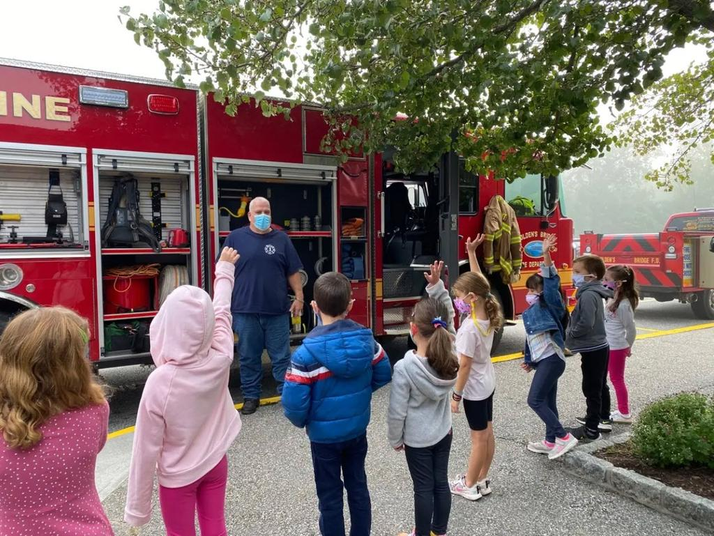Students at Increase Miller Elementary School eagerly asked questions as Golden's Bridge Firefighter Joe Simoncini gave a talk about fire safety when a team of GBFD firefighters visited the school during National Fire Prevention Week. (GBFD)