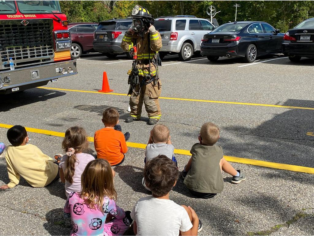 Golden's Bridge Firefighter Doug Orlovitz demonstrated a breathing apparatus to attentive students at Increase Miller Elementary School at the GBFD's annual visit during National Fire Prevention Week. (GBFD)